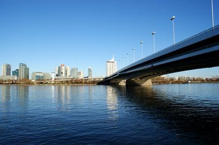 highriser: Vienna,Austria - office buildings around UNO city  and bridge above Danube river