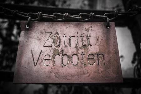 No trespassing signs  Zutritt verboten   hanging on chain  photo