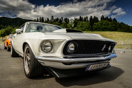 15 18: KNITTELFELD, AUSTRIA - MAY 18  Axel Wiesner in a 1969 Ford Mustang Boss Clone participates in a rally for vintage cars  15 Murtal Classic  on May 18, 2013 in Knittelfeld, Austria