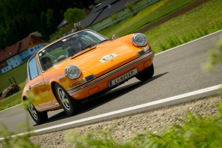 15 18: KNITTELFELD, AUSTRIA - MAY 18  Joachim Hofstadler in a 1970 Porsche 911 T Targa participates in a rally for vintage cars  15 Murtal Classic  on May 18, 2013 in Knittelfeld, Austria
