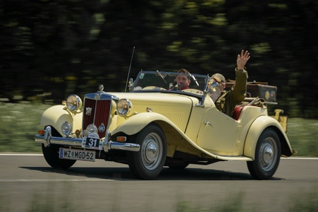 td: KNITTELFELD, AUSTRIA - MAY 18 Gerald Dunst in a 1952 MG TD participates in a rally for vintage cars  15 Murtal Classic  on May 18, 2013 in Knittelfeld, Austria  Editorial