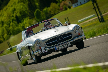 15 18: KNITTELFELD, AUSTRIA - MAY 18 Maria Deu in a 1963 Mercedes 190 SL participates in a rally for vintage cars  15 Murtal Classic  on May 18, 2013 in Knittelfeld, Austria