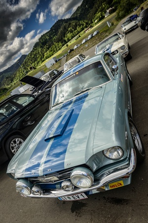 KNITTELFELD, AUSTRIA - MAY 18 Erich Volk in a 1965 Ford Mustang Fastback participates in a rally for vintage cars  15 Murtal Classic  on May 18, 2013 in Knittelfeld, Austria  Editorial