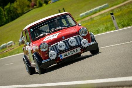 KNITTELFELD, AUSTRIA - MAY 18 Michael Bele in a 1971 Mini Cooper S MK 3 participates in a rally for vintage cars  15 Murtal Classic  on May 18, 2013 in Knittelfeld, Austria