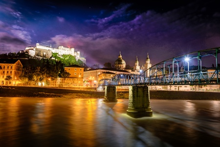 Night view of Salzburg and Mozart bridge over Salzach river in foreground, Austria  Historic Centre of the City of Salzburg photo