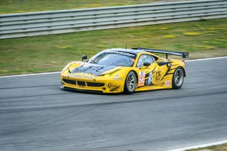 luft: SPIELBERG, AUSTRIA - JULY 20 Andrea Bertolini of JMW Motorsport Team on Ferrari F458 Italia participates in a rally for European Le Mans Series on July 28, 2013 in Spielberg, Austria