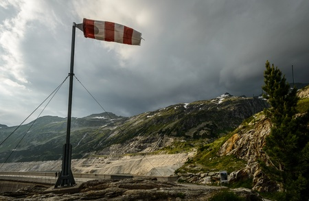 gusty: Windsock during strong wind in Alps