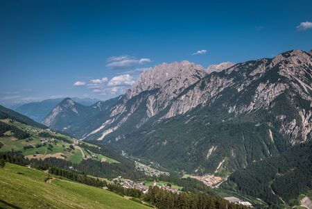 Summer landscape with green field and mountains -Lienz Dolomiten,Austria  photo