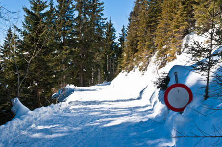 Sign close to the road covered with deep snow  Koralpe ,Austria  photo