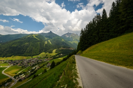 Beautiful landscape with village and road in the austrian alps  photo