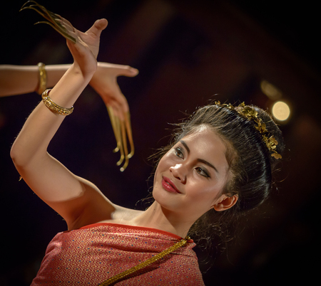 traditionally: CHIANG MAI, THAILAND - FEBRUARY 16  Unidentified lady performing the finger nail dance traditionally performed to welcome guests  16 February 2014 in Chiang Mai, Thailand
