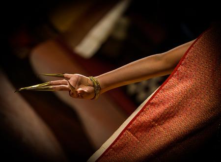 thai dancing: Traditional Thai dance performance-details hand with long fingernails,Thailand