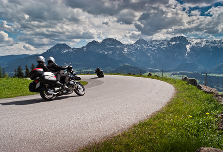 Motorbikes on the road in mountains with Alps in background Salzkammergut,Austria