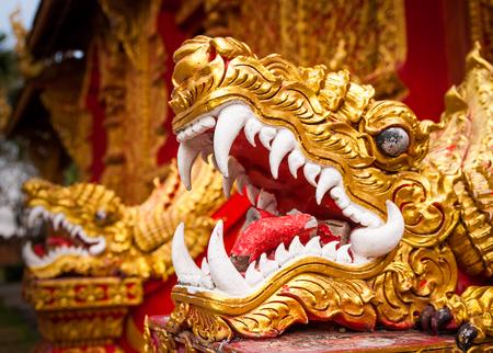 naga china: Closeup of golden,old dragon statue,Thailand