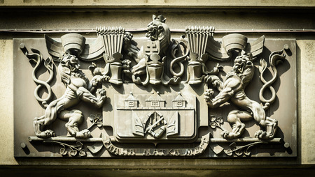 Bas -Relief - arms of Prague on the building facade  Czech Republic  photo