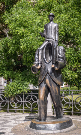 existentialism: PRAGUE, CZECH REPUBLIC - MAY 23, 2014  Monument to famous writer Franz Kafka in Jewish Quarter of Prague  Unusual memorial was inaugurated in 2003, work of sculptor Jaroslav Rona