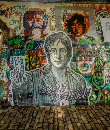 PRAGUE, CZECH REPUBLIC - May 24 The Lennon Wall since the 1980s filled with John Lennon-inspired graffiti and pieces of lyrics from Beatles songs on May 24, 2014 in Prague, Czech Republic