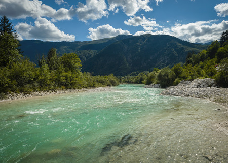 Emerald green waters of the alpine river Soca in Slovenia  photo