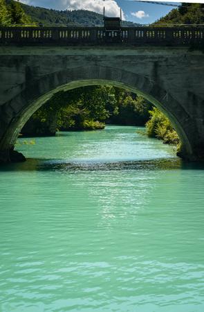 Emerald green waters of the alpine river Soca in Most na Soci ,Slovenia. photo
