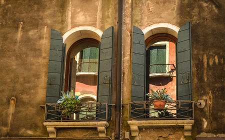 Traditional window of typical old Venice building ,Italy. photo