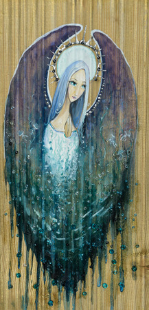 sectional: Beautiful angel with water drops painted on a wood. Stock Photo