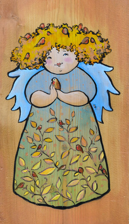 sectional: Cute angel with small bird in hand painted on a wood.