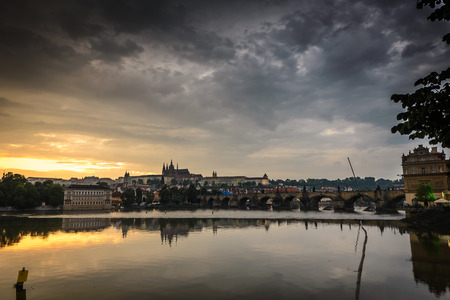 Vltava river and a Prague Castle in background at sunset ,Czech Republic . photo