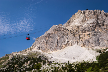 Red cable car -Passo Falzarego,Dolomites,Italy. photo