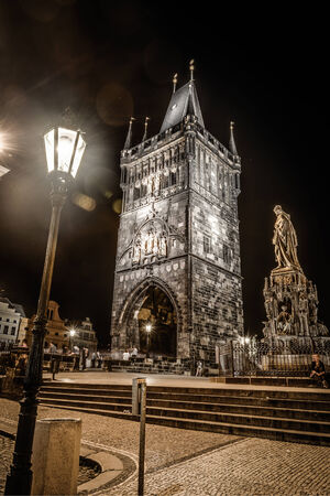 Night photo of Lesser Bridge Tower at Charles Bridge ,Prague,Czech Republic photo