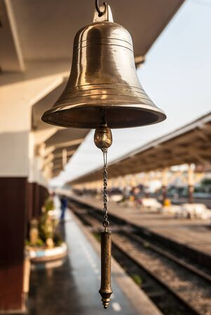 brassy: Closeup of a brassy bell at Thailands train station. Stock Photo