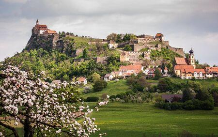 steiermark: Landscape with castle Riegersburg and flowering apple tree in foreground, Steiermark, Austria.