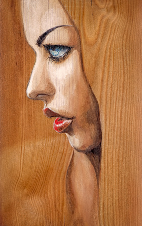 blue eyes: Watercolor illustration-beautiful woman with blue eyes painted on a wood.