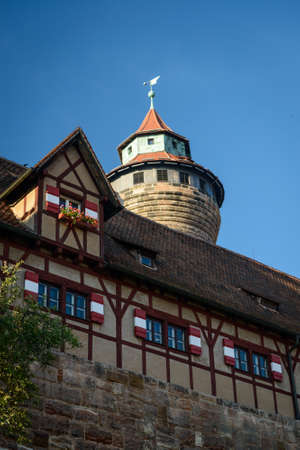 bayern old town: Nuremberg Castle Sinwell tower with blue sky and clouds, Germany