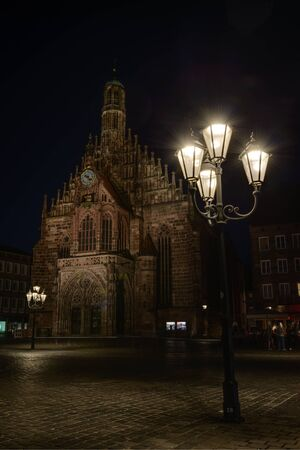 hauptmarkt: Night shot of Church of Our Lady Frauenkirche, with street lamp in foreground.Nuremberg, Germny