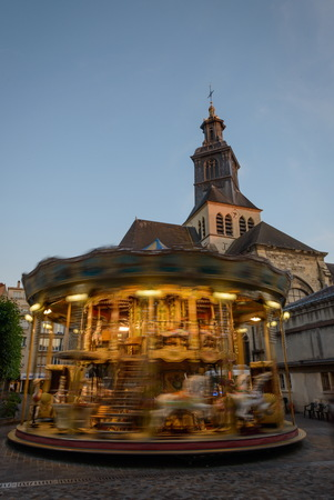carousel horse: Blurry  long exposure image of a brightly lit Carousel horse ride,Reims,France Stock Photo