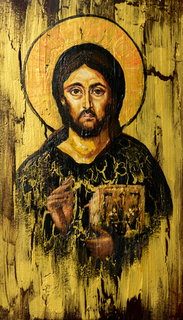 Hand painted picture of Jesus Christ Pantocrator styled on the old orthodox icon. Stock Photo