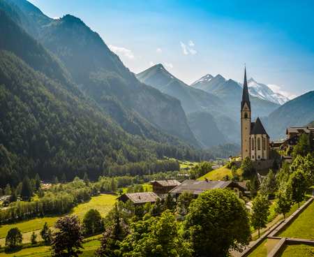 elevation: Rural landscape of Heiligenblut with St Vincent Church in Carynthia and Grossglockner 3797 m. elevation highest mountain from Austria in background.