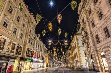 hauptplatz: GRAZ, AUSTRIA - DECEMBER 24, 2015: Street view of Herrengasse with Christmas decoration in Graz, Austria.Old town of Graz is the UNESCO World heritage.