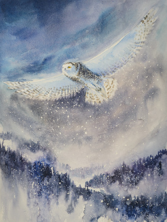 Winter. Snowy owl flying over mountains.