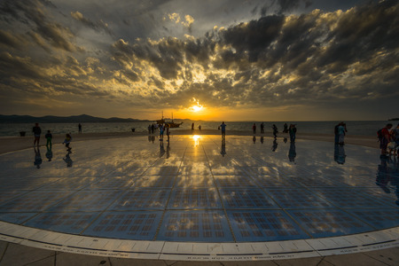 multilayer: ZADAR, CROATIA - Oct 14: Greeting to the Sun, designed by architect Nikola Basic. It Consists of 300 multilayer glass panels in form of a 22 m diameter circle. October 14, 2015