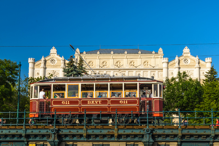 atraction: Budapest- MAY 28: People traveling with old tram to the Danube Promenade on 28, 2016 in Budapest, Hungary.