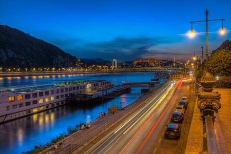 elisabeth: Night view of Budapest, Hungary.Cars on a street and the Danube river with Elisabeth Bridge in background Stock Photo