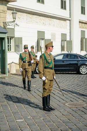 guarded: BUDAPEST - MAY 26: Presidential guard on 26 May 2016, Budapest, Hungary. Hungarys presidential office in the Castle District is heavily guarded by presidential guards.