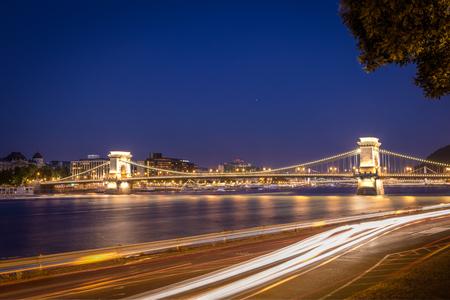 szechenyi: Night shot of Szechenyi Chain Bridge is a suspension bridge spans the River Danube of Budapest, the capital of Hungary. Stock Photo