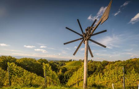 steiermark: Styrian Tuscany Vineyard with windmill -klapotetz in foreground, Austria Stock Photo