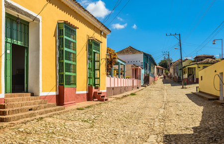Colorful houses on the cobblestone streets in the city center of Trinidad Cuba.