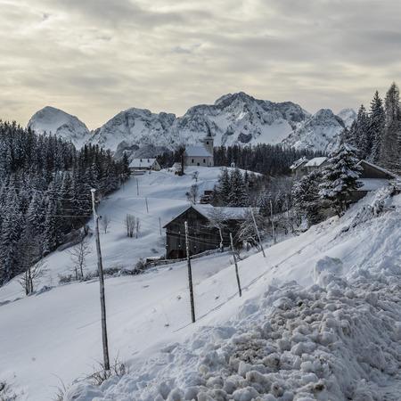 Snowy, winter landscape with  panoramic road, Logarska Dolina,Slovenia.A popular tourist and travel destination.