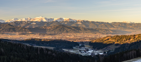 Panorama of Spierlberg-city in Austria with Red Bull Ring race circuit with Alps covered with snow in background.