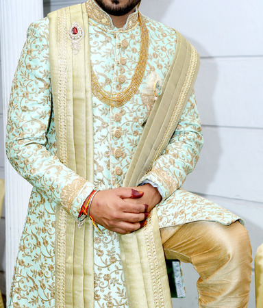 picture of handsome groom dressed in rich ethnic Indian style for a wedding