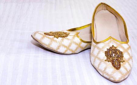 Indian grooms wedding khussa shoes 版權商用圖片